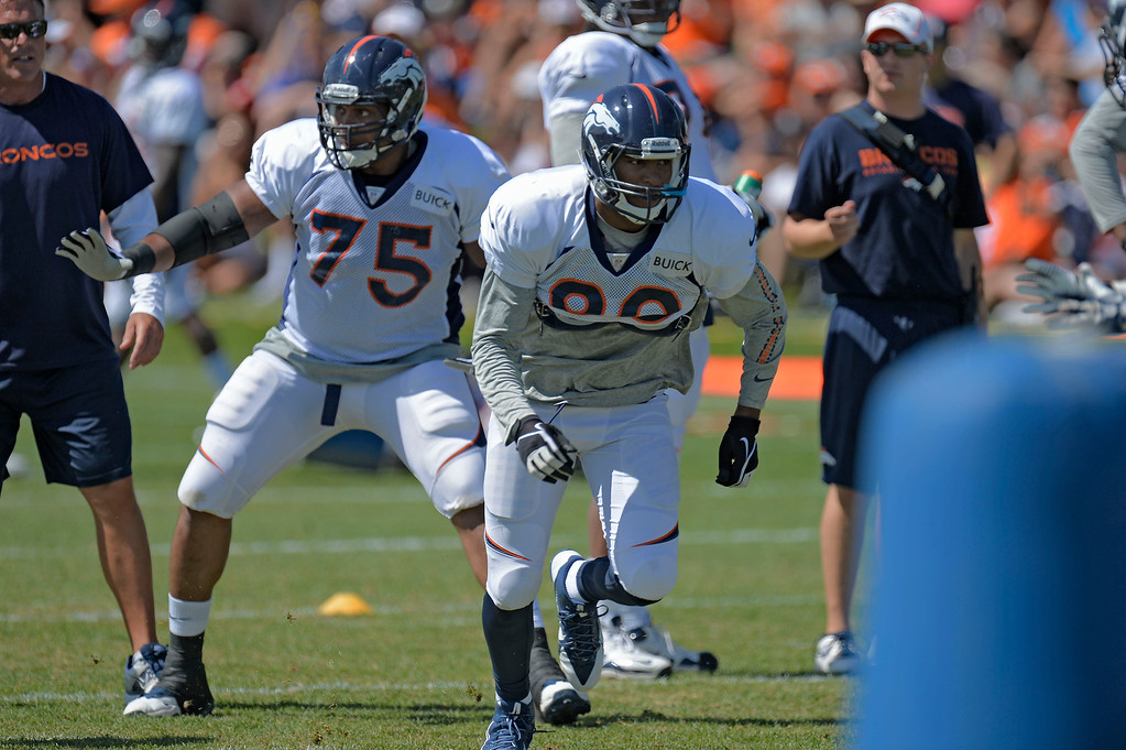 . Denver Broncos TE Julius Thomas (80) runs through drills during training camp August 5, 2013 at Dove Valley. (Photo By John Leyba/The Denver Post)