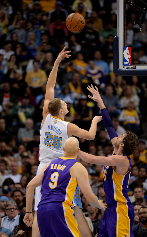 . DENVER, CO - NOVEMBER 13: Denver Nuggets center Timofey Mozgov (25) hits a jump hook over Los Angeles Lakers center Pau Gasol (16) during the third quarter November 13, 2013 at Pepsi Center. Timofey Mozgov had a team high 23 points. (Photo by John Leyba/The Denver Post)