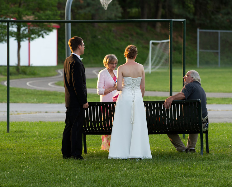 At the park bench after reception.jpg