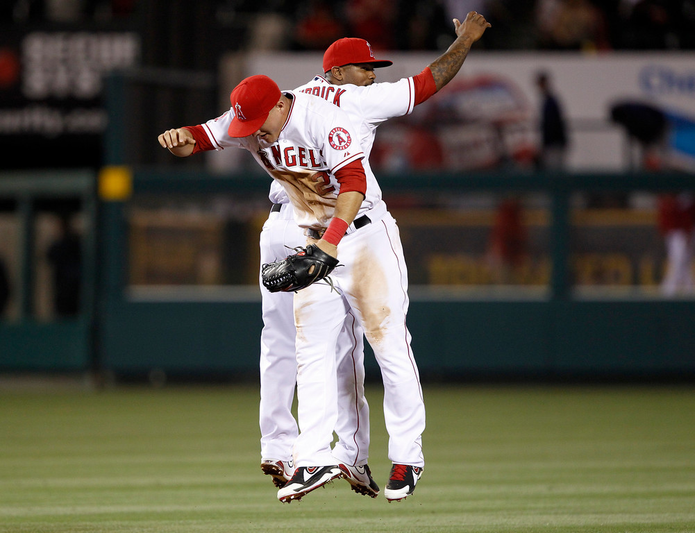 . Los Angeles Angels center fielder Mike Trout, left, leaps in celebration with Angels second baseman Howie Kendrick after Trout hit for the cycle to defeat the Seattle Mariners during a 12-0 win in a baseball game Tuesday, May 21, 2013 in Anaheim.    (AP Photo/Alex Gallardo)