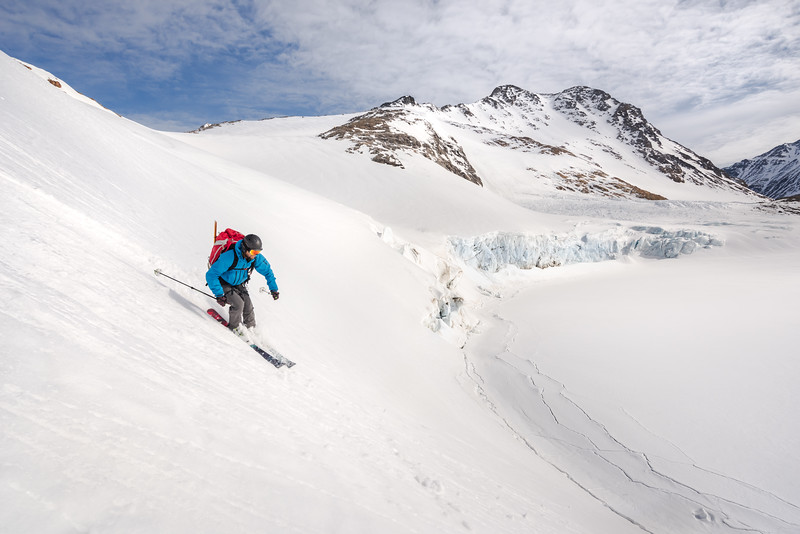 Chris Ball descending to the sea ice from Apusiaajik, East Greenland