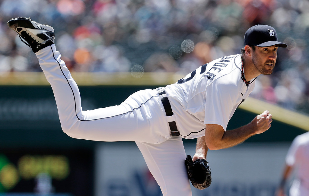 . Detroit Tigers pitcher Justin Verlander throws against the Toronto Blue Jays in the first inning of a baseball game in Detroit, Thursday, June 5, 2014. (AP Photo/Paul Sancya)