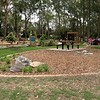 brick garden edging and rock and native grasses planting and picnic table and benches