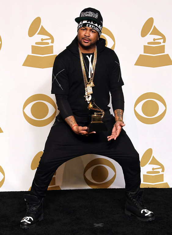 ". The-Dream poses backstage with the awards for best rap/sung collaboration for ""No Church in the Wild\"" at the 55th annual Grammy Awards on Sunday, Feb. 10, 2013, in Los Angeles. (Photo by Matt Sayles/Invision/AP)"