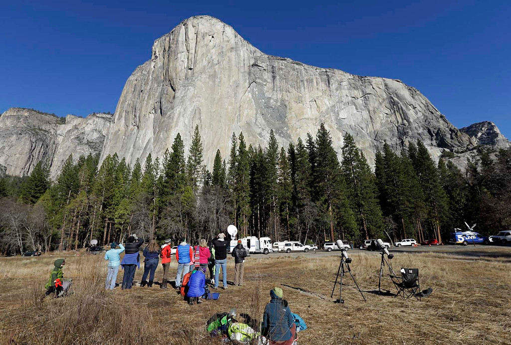 . Spectators gaze at El Capitan for a glimpse of climbers Tommy Caldwell and Kevin Jorgeson on Wednesday, Jan. 14, 2015, as seen from the valley floor in Yosemite National Park, Calif. Caldwell and Jorgeson became the first to free-climb the rock formation\'s Dawn Wall. They used ropes and safety harnesses to catch them in case of a fall, but relied entirely on their own strength and dexterity to ascend by grasping cracks as thin as razor blades and as small as dimes. (AP Photo/Ben Margot)