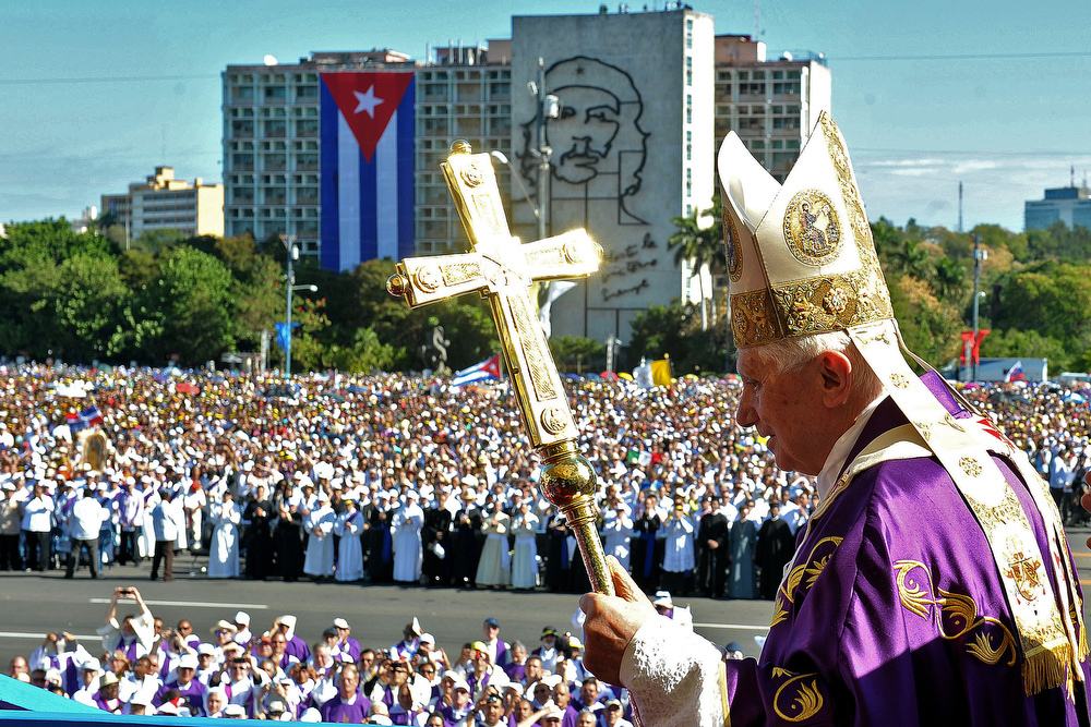 . A file handout picture taken on March 28, 2012 and released by the Osservatore Romano shows Pope Benedict XVI arriving for the holy mass at Revolution Square in Havana. Pope Benedict XVI announced on February 11, 2013 he will resign on February 28 because his age prevented him from carrying out his duties, an unprecedented move in the modern history of the Catholic Church.  AFP PHOTO / OSSERVATORE ROMANO