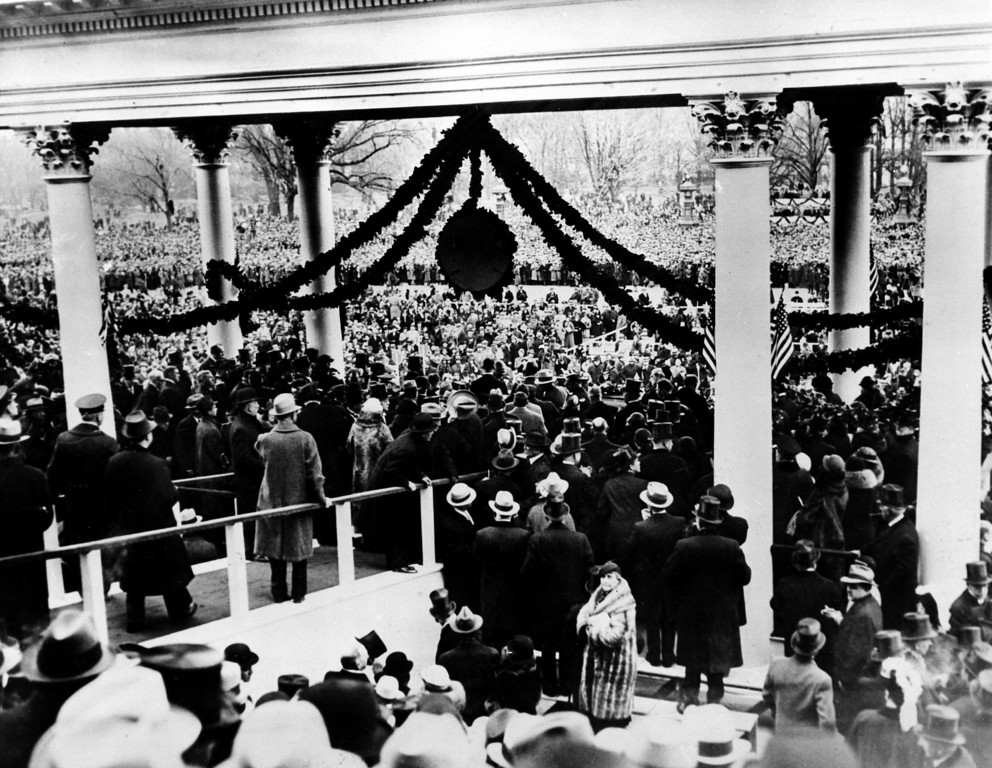 . This view of the rostrum, where President Franklin D. Roosevelt declared his leadership after taking his oath, looks out at the large crowd just as the inauguration ceremonies concluded at Immense Plaza in Washington, D.C., March 4, 1933.  Directly under the suspended disc is outgoing President Herbert Hoover, smiling, saying goodbye to his successor.  (AP Photo)