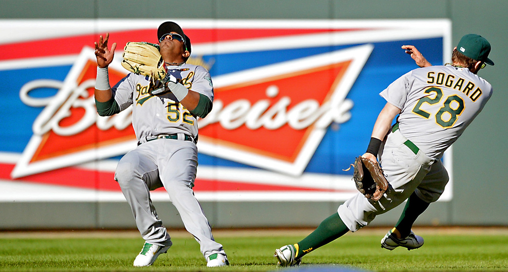 . Oakland second baseman Eric Sogard narrowly avoids left fielder Yoenis Cespedes, who waits on a pop fly out from Minnesota\'s Kurt Suzuki in the sixth inning. (Pioneer Press: John Autey)