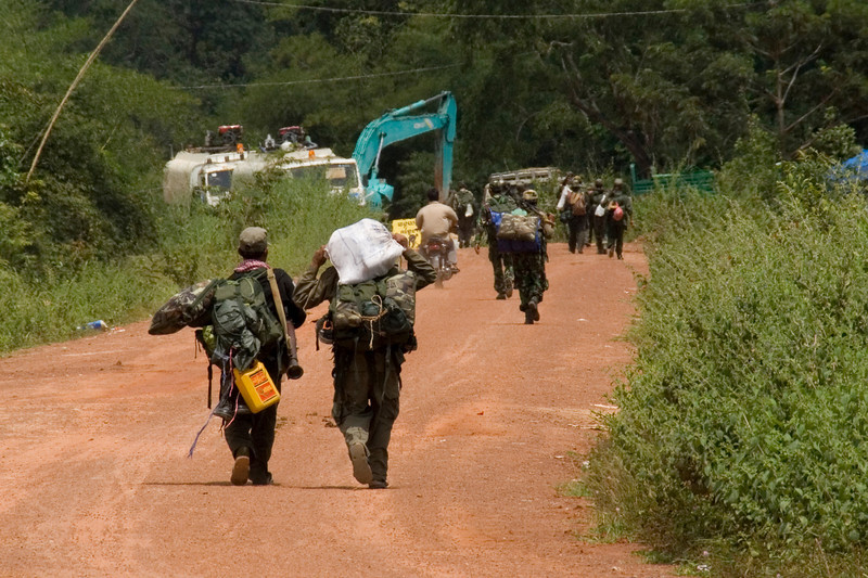 Soldiers walking and carrying gears in Preah Vihear, Cambodia