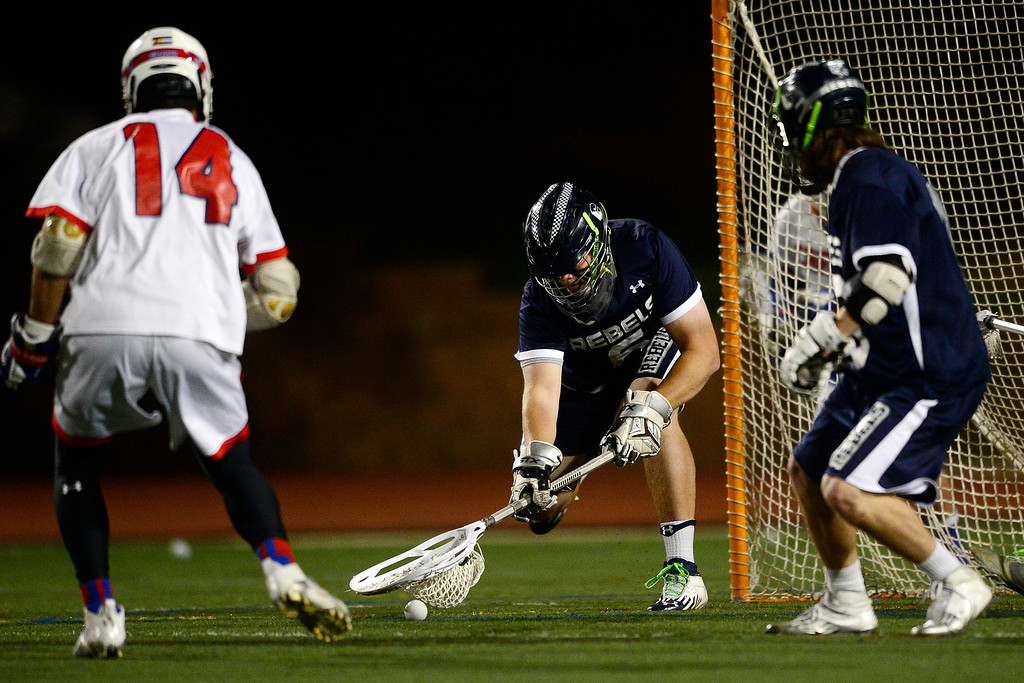 . Columbine\'s Evan Hartman defends the net during Cherry Creek\'s 7-6 win.  (Photo by AAron Ontiveroz/The Denver Post)
