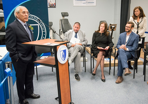 10/03/19 Wesley Bunnell | StaffrrCCSU officially opened the Dr. Antone B. Capitao Biomechanics Laboratory Classroom with a ribbon cutting on Thursday October 3, 2019. Dr. Capitao, L, speaks to the audience. Seated are Dr. Christopher Galligan, Dr. Kimberly Kostelis and Dr. Jason Melnyk.