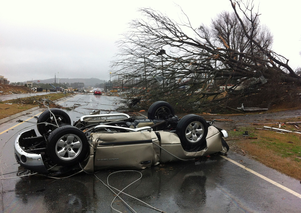 Description of . A vehicle lies on a road after a tornado moved through Adairsville, Ga. on Wednesday, Jan. 30, 2013. A fierce storm system that roared across northwest Georgia has left at least one person dead and a trail of damage that included demolished buildings in downtown Adairsville and vehicles overturned on Interstate 75 northwest of Atlanta. (AP Photo/David Goldman)