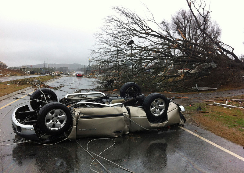 . A vehicle lies on a road after a tornado moved through Adairsville, Ga. on Wednesday, Jan. 30, 2013. A fierce storm system that roared across northwest Georgia has left at least one person dead and a trail of damage that included demolished buildings in downtown Adairsville and vehicles overturned on Interstate 75 northwest of Atlanta. (AP Photo/David Goldman)