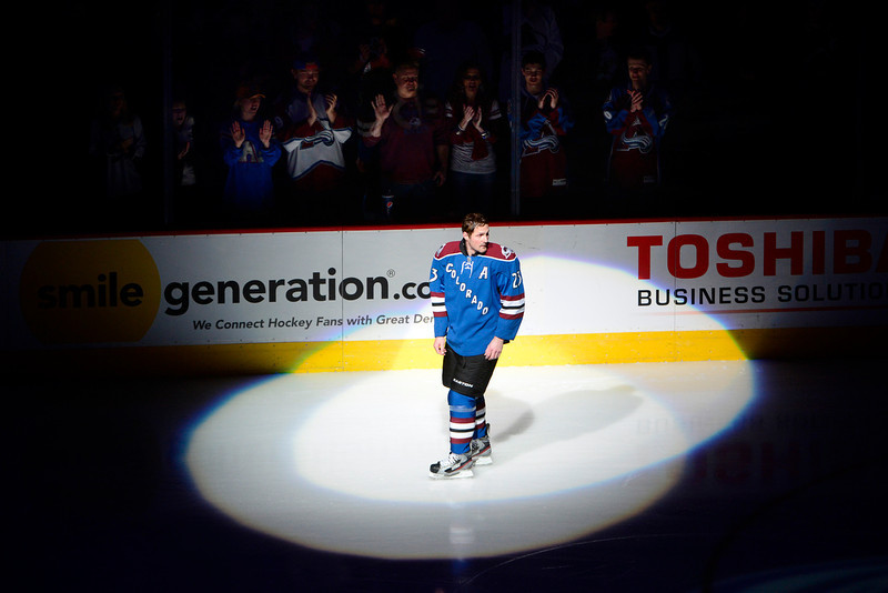 . Fans cheer Milan Hejduk (23) of the Colorado Avalanche for playing in his 1,000th career game before the first period of action. Colorado Avalanche versus the Dallas Stars at the Pepsi Center on February 4, 2012. (Photo By AAron Ontiveroz/The Denver Post)