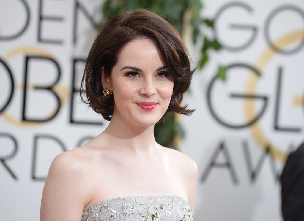 . Michelle Dockery arrives at the 71st annual Golden Globe Awards at the Beverly Hilton Hotel on Sunday, Jan. 12, 2014, in Beverly Hills, Calif. (Photo by Jordan Strauss/Invision/AP)