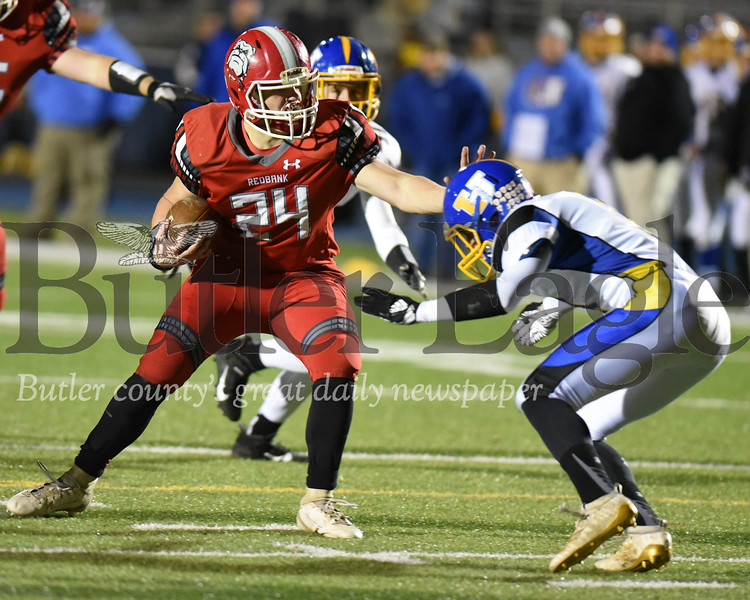Harold Aughton/Butler Eagle: Redbank Valley's Ray Shreckengost, #24, fends off Union/A.C. Valley's Karter Vogle,#3, at the end of the second quarter