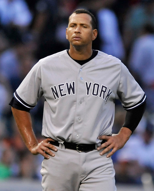 . New York Yankees\' Alex Rodriguez looks on during the third inning of a baseball game against the Chicago White Sox in Chicago, Monday, Aug. 5, 2013. (AP Photo/Paul Beaty)