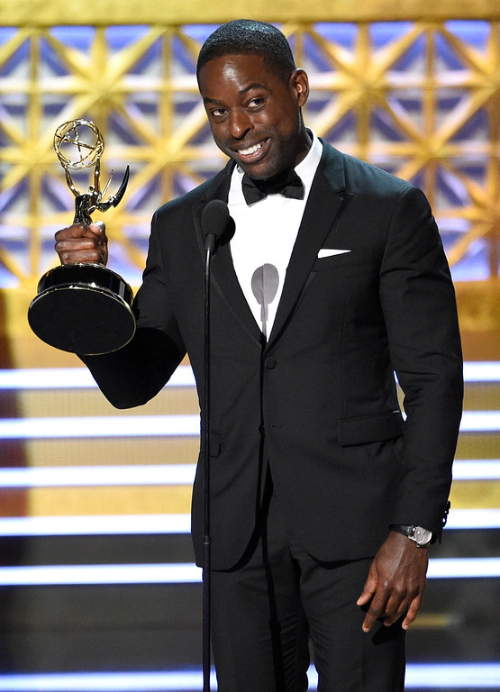 """. Sterling K. Brown accepts the award for outstanding lead actor in a drama series for \""""This Is Us\"""" at the 69th Primetime Emmy Awards on Sunday, Sept. 17, 2017, at the Microsoft Theater in Los Angeles. (Photo by Chris Pizzello/Invision/AP)"""