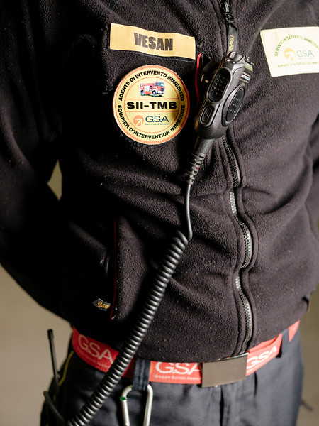 Detail of Simone Vesan badge, direct response crew (professional firefighters) in the firefighter hangar on the French side - Samuel Zeller for the New York Times