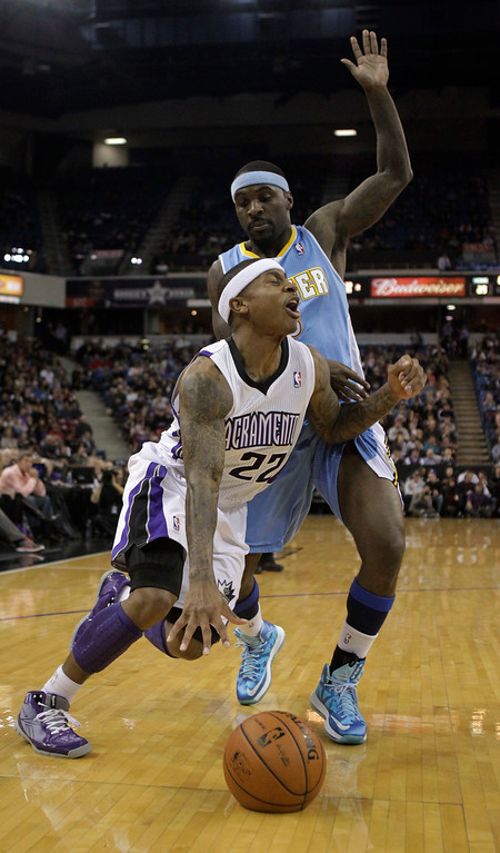 . Sacramento Kings guard Isaiah Thomas is fouled by Denver Nuggets guard Ty Lawson during the second quarter of an NBA basketball game in Sacramento, Calif., Sunday, Dec. 16, 2012.(AP Photo/Rich Pedroncelli)