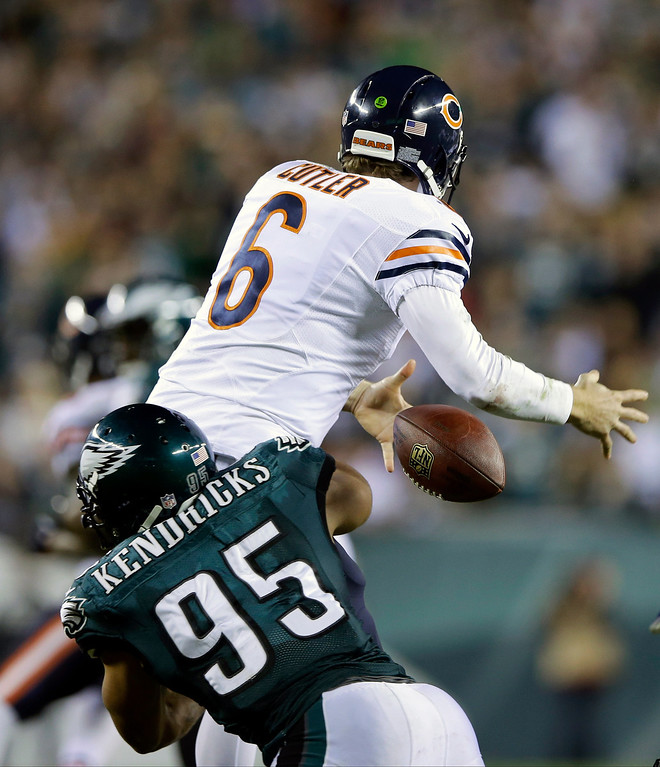 . Chicago Bears\' Jay Cutler (6) fumbles the ball as he is hit by Philadelphia Eagles\' Mychal Kendricks (95) during the second half of an NFL football game, Sunday, Dec. 22, 2013, in Philadelphia. (AP Photo/Michael Perez)