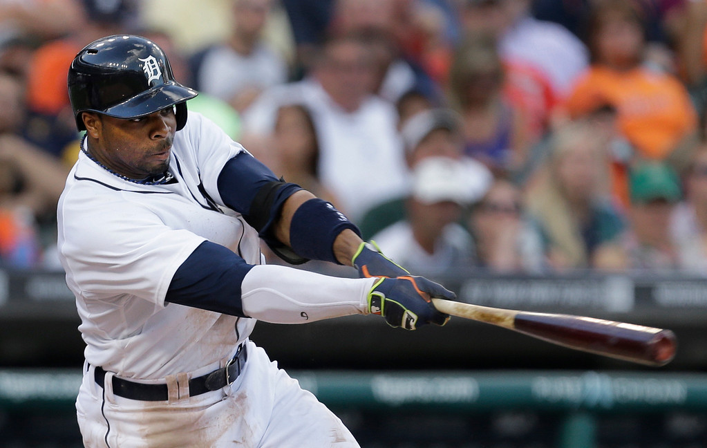 . Detroit Tigers\' Rajai Davis hits an RBI  double against the Kansas City Royals in the third inning of a baseball game in Detroit, Monday, June 16, 2014.  (AP Photo/Paul Sancya)