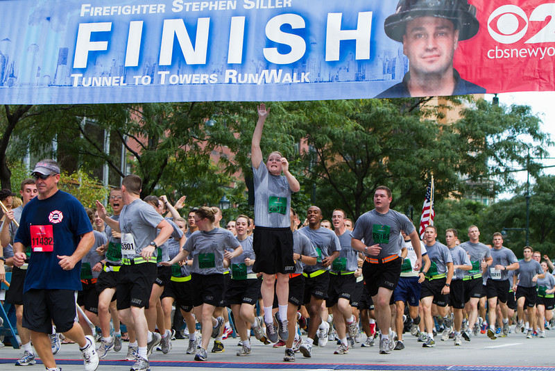 Cadet Molly Yardley jumps up to touch the Finish Line banner at the end of the Tunnels to Tower Run, September 25, 2011.