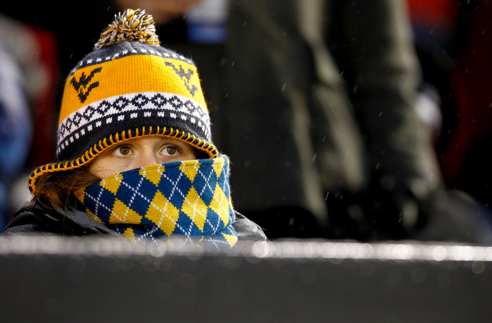 Description of . A West Virginia Mountaineers fan watches as they face the Syracuse Orangein the New Era Pinstripe Bowl at Yankee Stadium on December 29, 2012 in the Bronx borough of New York City.  (Photo by Jeff Zelevansky/Getty Images)