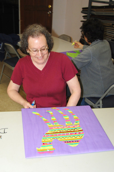 """A few weeks before the workshop, we had a """"craft night"""" at club and everyone participated in decorating camels. It was fun and amazing how many different variations people came up with. Photo by Chris Louder."""