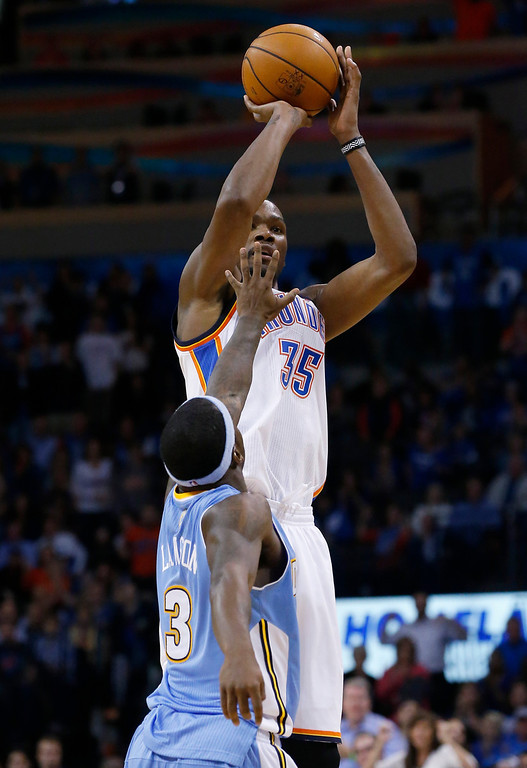 . Oklahoma City Thunder forward Kevin Durant (35) shoots over Denver Nuggets guard Ty Lawson (3) in the fourth quarter of an NBA basketball game in Oklahoma City, Monday, Nov. 18, 2013. Oklahoma City won 115-113. (AP Photo/Sue Ogrocki)