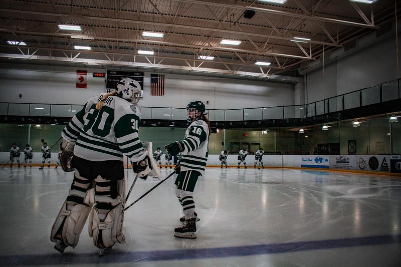 Holy Family Girls Varsity Hockey vs. Mound Westonka, 12/10/19: Sedona Blair '23 (30) and Maddie Morgan '22 (16)