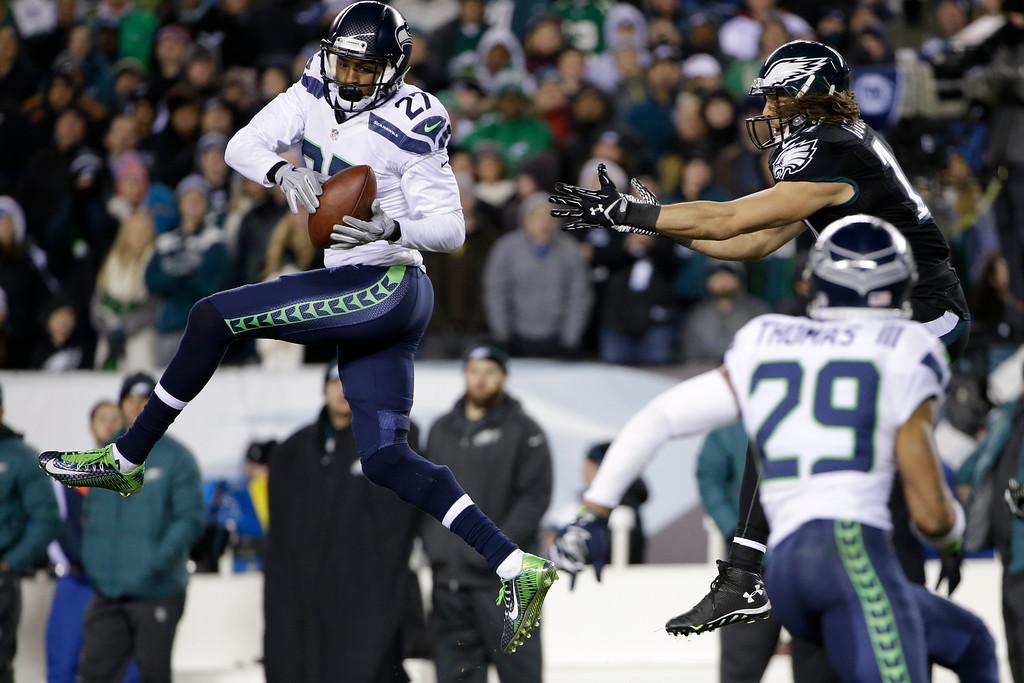. Seattle Seahawks\' Tharold Simon (27) intercepts a pass intended for Philadelphia Eagles\' Riley Cooper (14) during the second half of an NFL football game, Sunday, Dec. 7, 2014, in Philadelphia. (AP Photo/Matt Rourke)