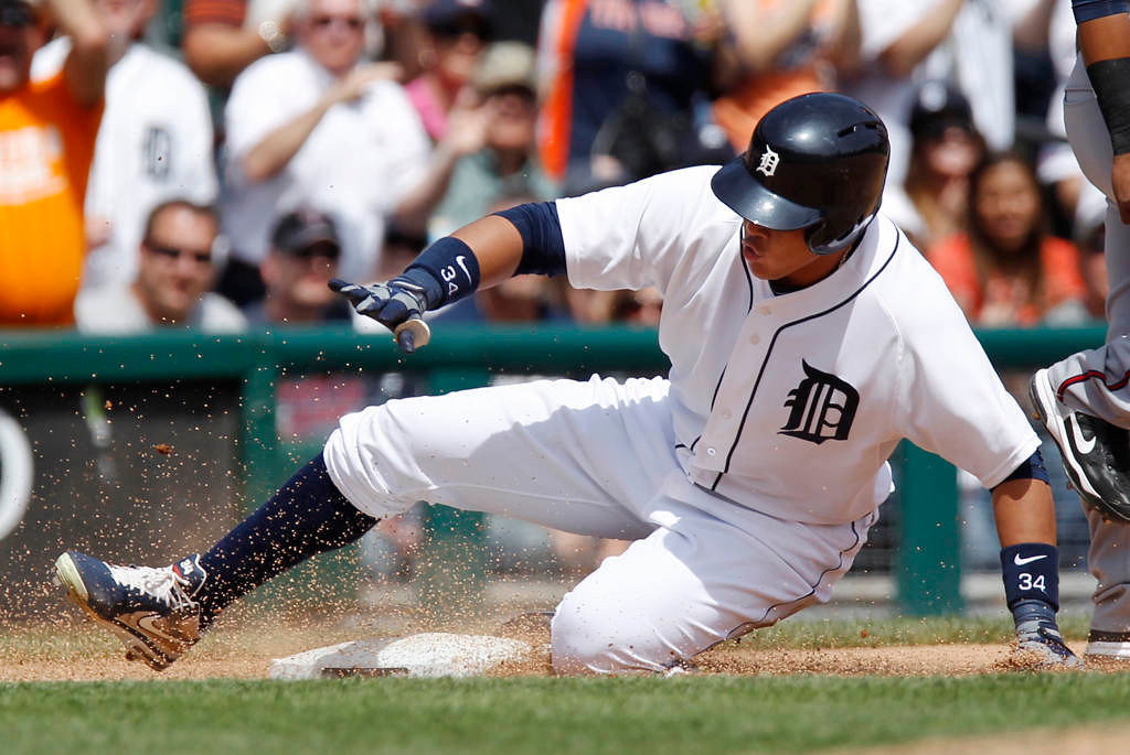 . DETROIT, MI - MAY 26:  Avisail Garcia #34 of the Detroit Tigers slides into third base with a bases loaded triple against the Minnesota Twins in the sixth inning at Comerica Park on May 26, 2013 in Detroit, Michigan. (Photo by Duane Burleson/Getty Images)