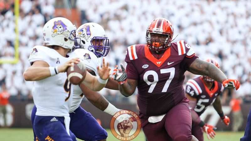 DT Tim Settle (97) gets past the ECU OL on a rush at the quarterback in the second quarter.  (Mark Umansky/TheKeyPlay.com)