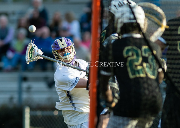 Broughton boys varsity lacrosse vs Enloe. March 10, 2020. D4S_8033