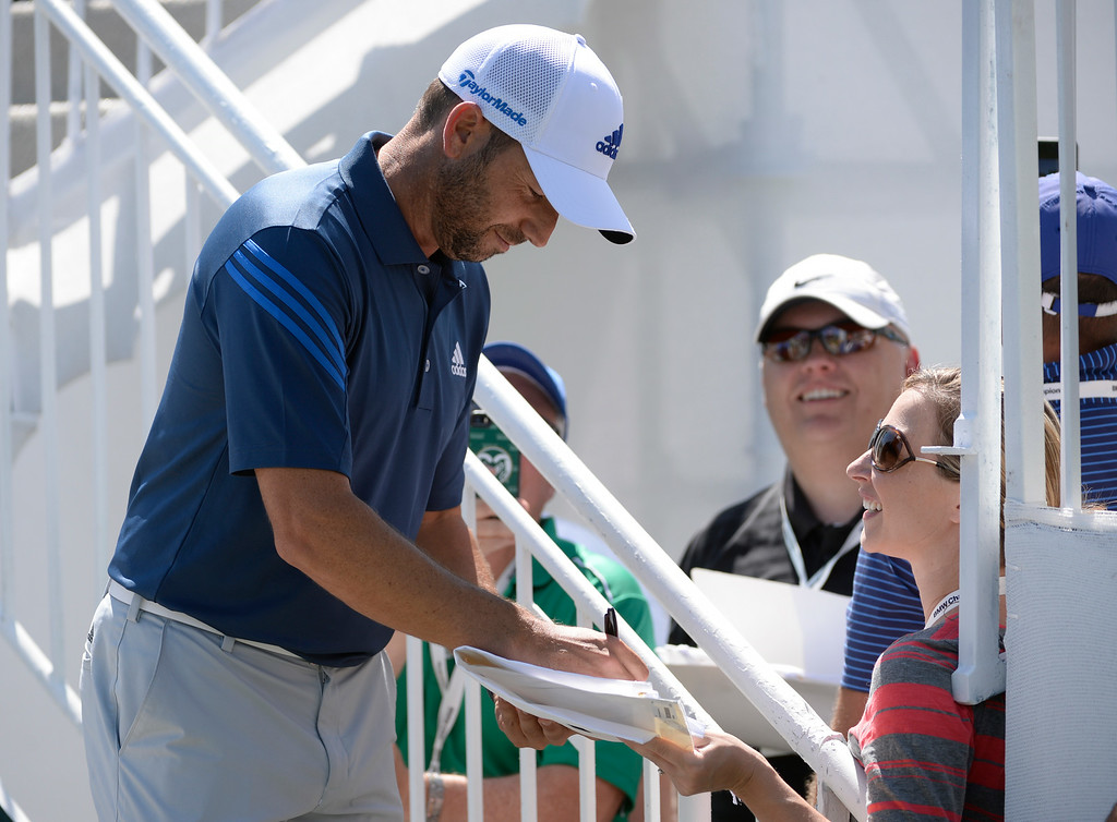 . CHERRY HILLS VILLAGE, CO. - SEPTEMBER 02:  Pro golfer, Sergio Garcia, signs a few autographs for fans entering the driving range at the FedExCup BMW Championship at the Cherry Hills Country Club Tuesday, September 02, 2014 (Photo By Andy Cross / The Denver Post)