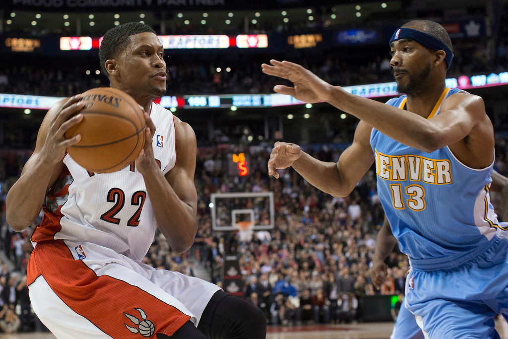 . Toronto Raptors\' Rudy Gay prepares to go up for the game-winning basket against Denver Nuggets\' Corey Brewer during an NBA basketball game in Toronto on Tuesday, Feb. 12, 2013. Toronto won 109-108. (AP Photo/The Canadian Press, Chris Young)