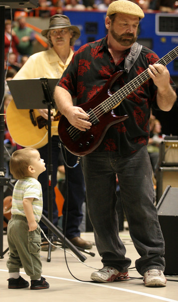 Wesley Martinez, 16 months old, is pretty interested in the bass player at the Boise, Idaho caucus.