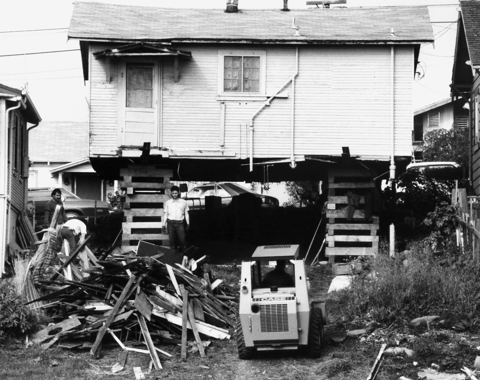 . A construction crew works at making repairs to an elevated and exposed house on a hill, Tuesday, Jan. 11, 1990, in Watsonville, Calif. Of the 3,200 Watsonville homes damaged in the October 17, 1989 earthquake, about one-third are being repaired. (AP Photo/Eric Risberg)