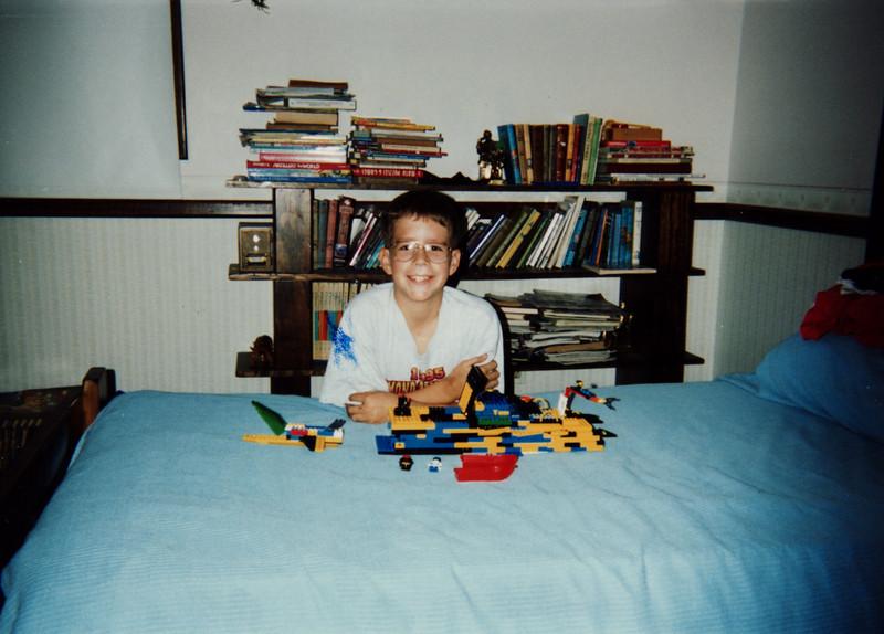 matt and lego on bed.jpg