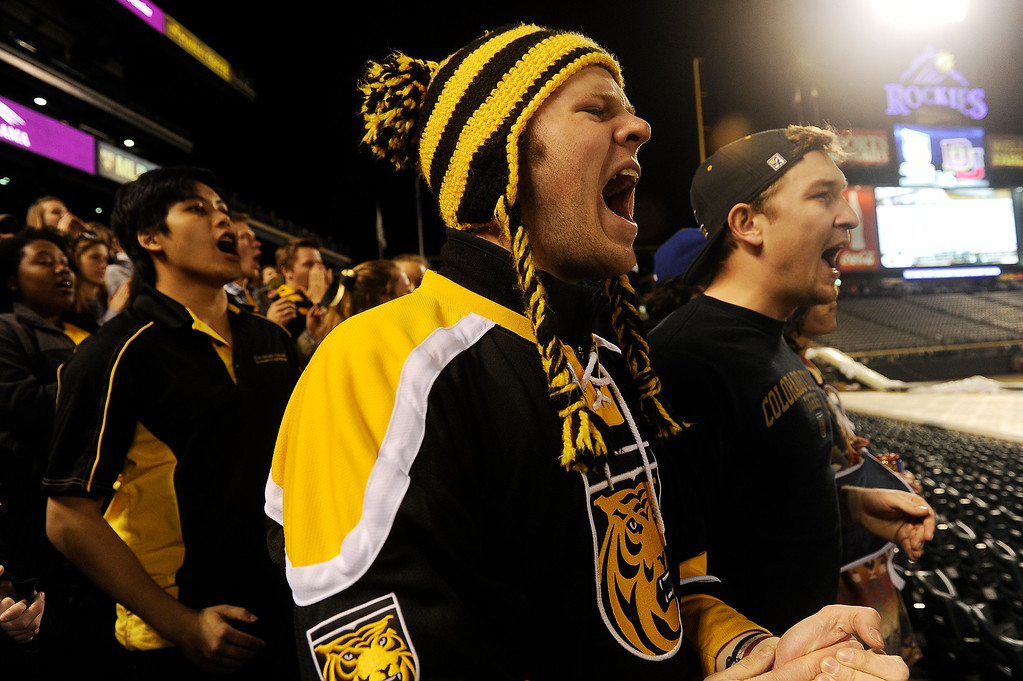 . Sergio Portesan, left, and David Mulcahy cheers on Colorado College as they take on the University of Denver Pioneers during the first period at Coors Field in Denver, Colorado on February 20, 2016. (Photo by Seth McConnell/The Denver Post)
