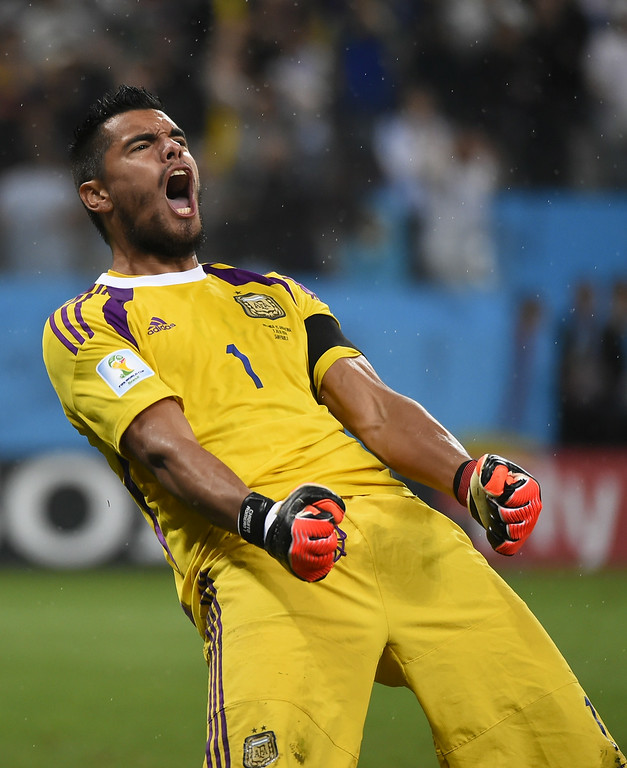 . Argentina\'s goalkeeper Sergio Romero reacts after saving the fourth penalty during the penalty shoot-out following extra time during the semi-final football match between Netherlands and Argentina of the FIFA World Cup at The Corinthians Arena in Sao Paulo on July 9, 2014.   FABRICE COFFRINI/AFP/Getty Images