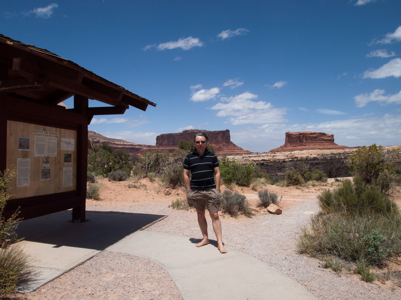 Roger is standing in front of the Monitor and Merrimac Buttes.  This is a scenic overlook area on the turnoff to Canyonlands Islands in the Sky near Moab