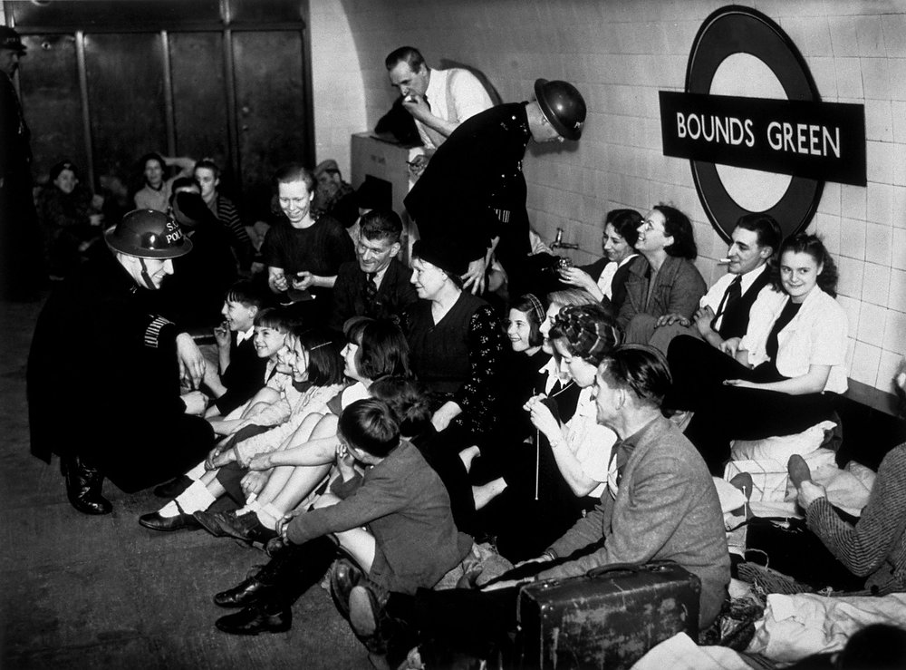 Description of . Sheltering from air raids at Bound's Green Underground station, London on Dec. 5, 1940.  (Photo by M. McNeill/Fox Photos/Getty Images)