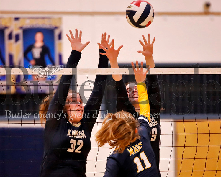 Knoch's Morgan Frishkorn (#32 left)  and Rory McCune (#29) go for a block over Mars' Katie Schlegel (#11). The Knights topped the Planets 3-0 Tuesday night at Knoch. Seb Foltz/Butler Eagle