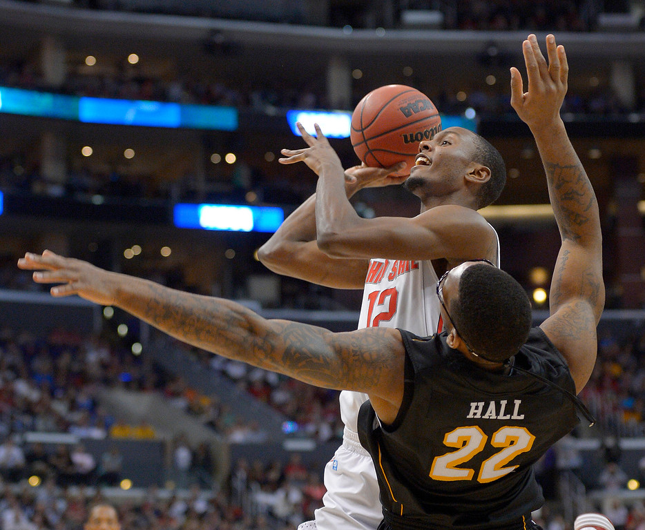 . Ohio State forward Sam Thompson drives against Wichita State forward Carl Hall during the second half of the West Regional final in the NCAA men\'s college basketball tournament, Saturday, March 30, 2013, in Los Angeles. (AP Photo/Mark J. Terrill)
