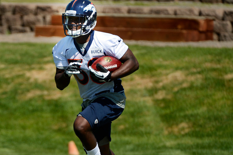 . Rookie running back # 38 Montee Ball gets his hands on the ball at Broncos rookie minicamp at the Broncos Dove Valley facility May 10, 2013 Centennial, Colorado. (Photo By Joe Amon/The Denver Post)