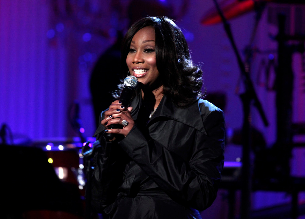 Description of . Yolanda Adams performs at a Black History Month event celebrating the music of the Civil Rights Movement hosted by President Barack Obama in the East Room of the White House in Washington, Tuesday, Feb. 9, 2010. (AP Photo/Charles Dharapak)
