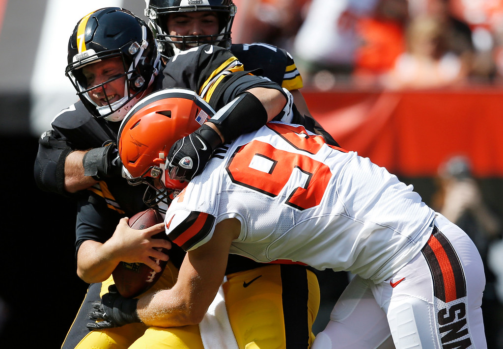 . Cleveland Browns defensive end Carl Nassib (94) sacks Pittsburgh Steelers quarterback Ben Roethlisberger (7) during the second half of an NFL football game, Sunday, Sept. 10, 2017, in Cleveland. (AP Photo/Ron Schwane)