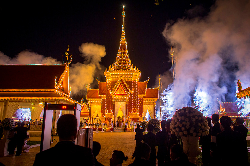 . People watch on as fireworks explode marking the end of the cremation ceremony on February 4, 2013 in Phnom Penh, Cambodia. The former King\'s cremation ceremony comes on the fourth day of a seven day royal funeral ceremony and nearly four months since his death in Beijing last October. Foreign leaders from 16 countries attended the cremation ceremony.  (Photo by Chris McGrath/Getty Images)